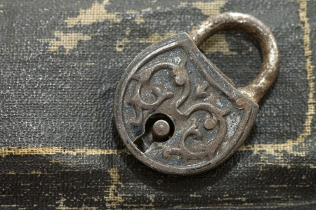 Photo pour The old lock isolated on a leather background - image libre de droit