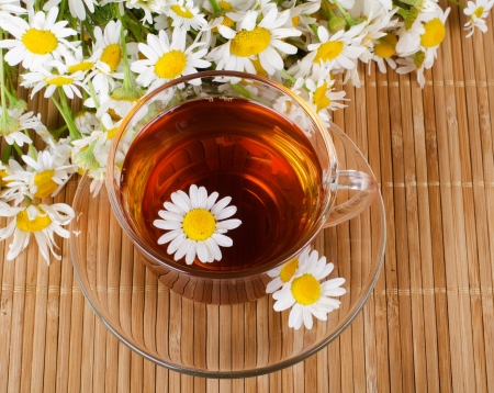 Glass cup with fragrant a camomile tea
