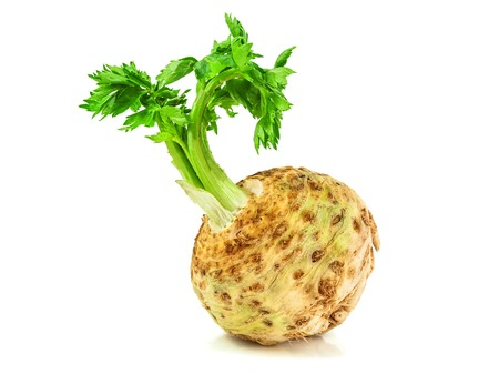 raw celery root on white background