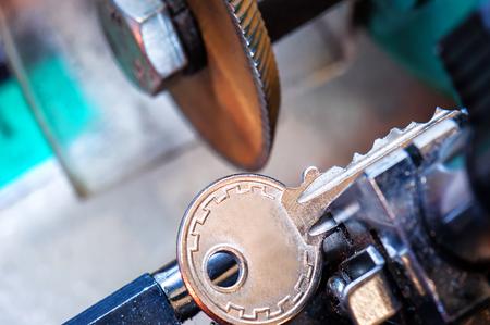 Photo for locksmith, key duplication machine makes new copy - Royalty Free Image