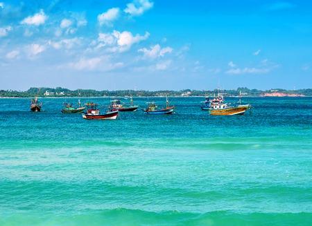 Photo pour fishing boats in the indian ocean - image libre de droit
