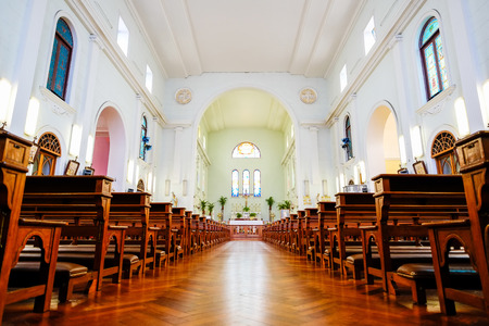 The interior view of traditional church with empty bench and aisle, the famous heritage in Macao/Macau, China