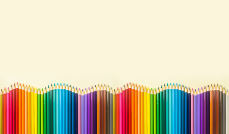 Photo for Art concept - Top view of color pencil wave on yellow paper background for mockup design - Royalty Free Image