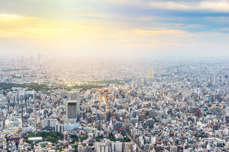 Foto de Asia Business concept for real estate and corporate construction - panoramic urban city skyline aerial view under twilight sky and golden sun in tokyo, Japan - Imagen libre de derechos