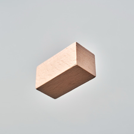 Business  and  design concept - Abstract geometric real floating wooden cuboid isolated on background, it's not 3D render.