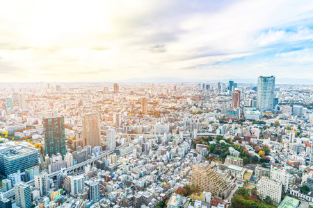 Foto de Asia Business concept for real estate and corporate construction - panoramic urban city skyline aerial view under bright blue sky and sun in Tokyo, Japan - Imagen libre de derechos
