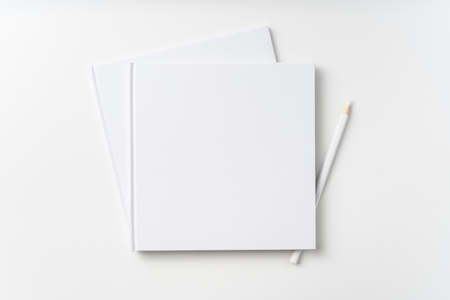 Photo pour Design concept - Top view of 2 pure white notebook, white page and pencil isolated on background for mockup - image libre de droit