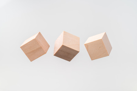 Business and design concept - Abstract geometric real floating wooden cuboid isolated on background