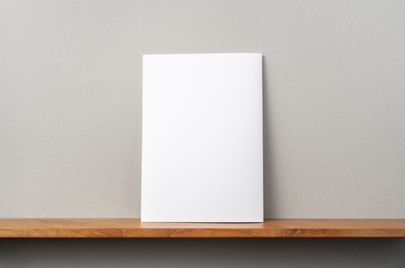 Photo pour Design concept - back view of A4 magazine stand on bookshelf and grey wall for mockup - image libre de droit
