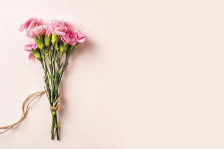Photo for Design concept - top view a bunch of carnation with hemp rope on pink background for mother day mockup - Royalty Free Image