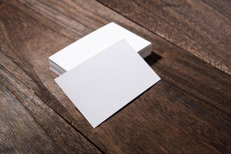 Photo pour Design concept - top view of white business cards on wood floor background - image libre de droit