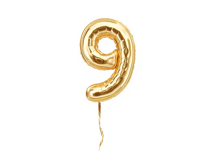 Foto de Numeral 9. Foil balloon number nine isolated on white background - Imagen libre de derechos