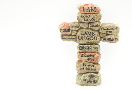 Stone crafted in cross shape with names of God for religion background