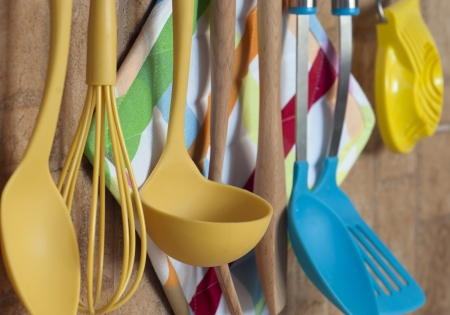 Set of kitchen tools hanging on the wall.