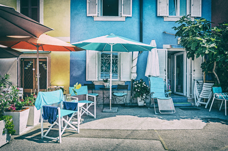 Photo pour Colorful guest houses in Piran, Slovenia. Architectural theme. Accommodation and services. Analog photo filter with scratches. - image libre de droit