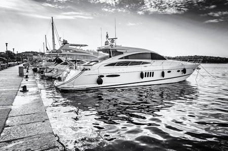 Photo for Yachts in port, Porec, Croatia. Summer vacation. Travelling theme. Mediterranean Sea. Black and white photo. - Royalty Free Image