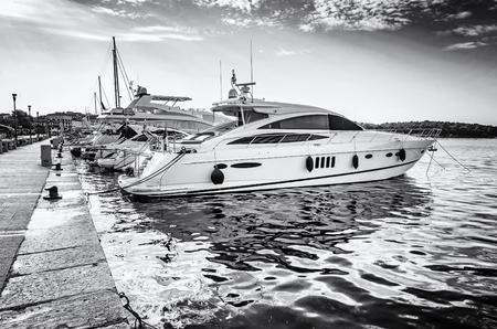 Photo pour Yachts in port, Porec, Croatia. Summer vacation. Travelling theme. Mediterranean Sea. Black and white photo. - image libre de droit