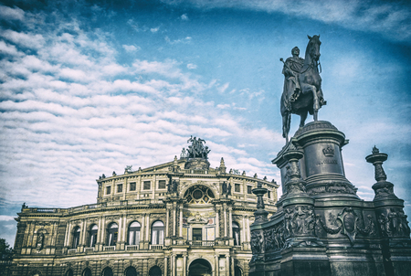 Semperoper and Statue of King Johann, Dresden, Germany. Architectural scene. Travel destination. Analog photo filter with scratches.