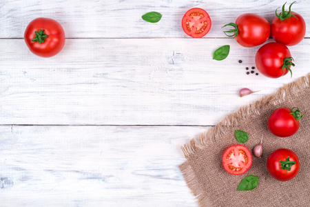 tomatoes on a white wooden table, pasta ingredients top view copy space