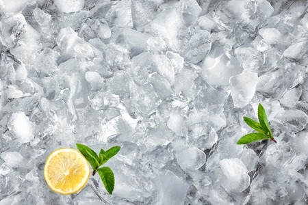 background with crushed ice cubes, top view