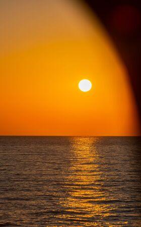 Foto de Sunset at 9pm from a yacht on the Mediterranean Sea off Kos Greece - Imagen libre de derechos