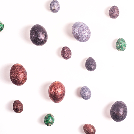 Photo for Brilliant Easter eggs in glitter of different colors on a white background. - Royalty Free Image