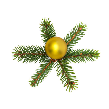 Photo pour Small spruce branches laid out in form of a six-pointed snowflake with a yellow shiny ball in the center on a white background - image libre de droit