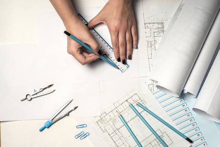 Photo pour Architect working on blueprint. - image libre de droit