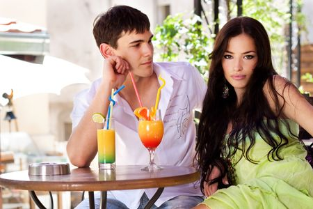 young couple in restaurant, outdoor, summer day