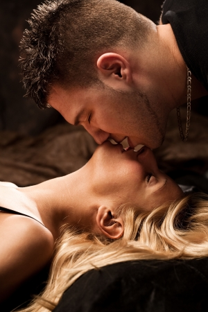 Photo for young passion lovers kissing, studio shot - Royalty Free Image