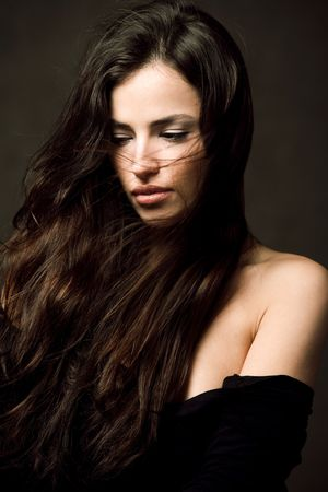 long hair brunette woman studio portrait