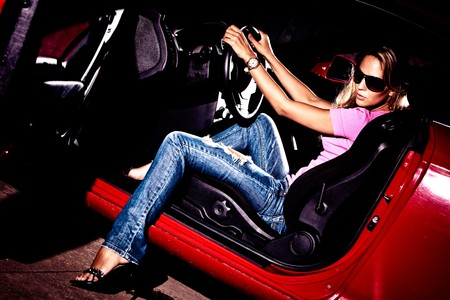 Photo for young  blond woman in car  - Royalty Free Image