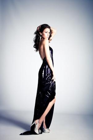 Photo for young brunette woman in long elegant dress, standing full body shot, studio shot - Royalty Free Image