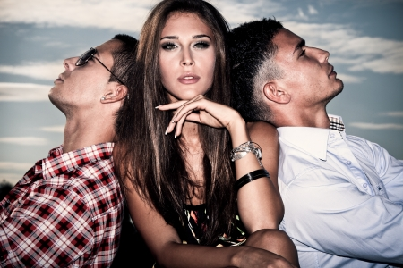 one young woman and two young men, love triangle, outdoors shot