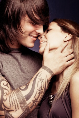 young beautiful smiling couple in hug