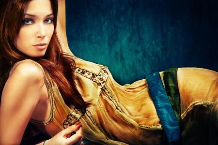 Foto de woman in oriental style clothes, studio shot - Imagen libre de derechos