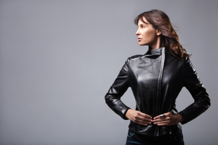 adult woman in black leather jacket, studio shotの写真素材