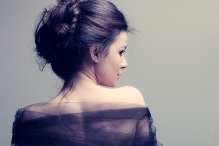 elegant woman with bun, back view profile, studio shot