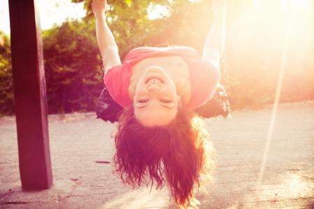 happy teen girl have fun on  swing sun flare