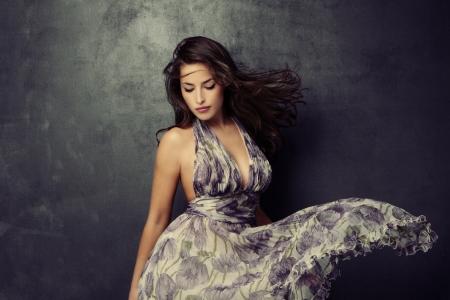 beautiful young  woman in an elegant dress studio shot