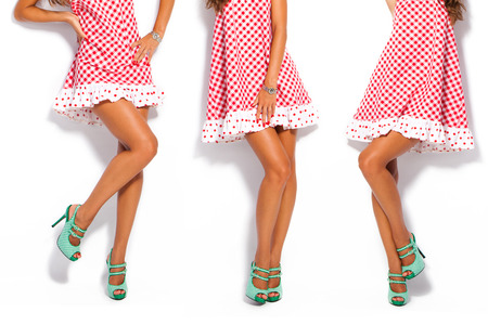 woman legs in summer high heel shoes and short red dress
