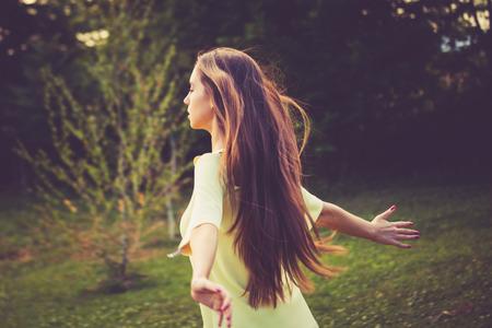 Foto de young woman enjoy in summer wind in nature - Imagen libre de derechos