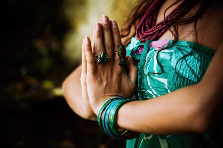 woman practice yoga outdoor close up of hands in namaste gesture