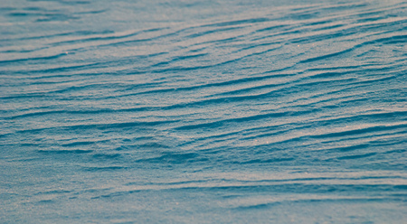 The texture of the snow closeup, abstract background, winter background