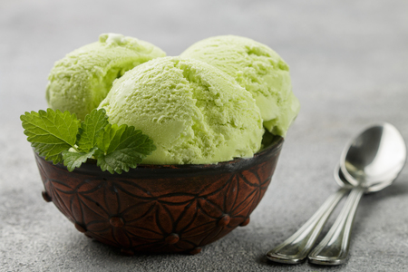 Photo pour Avocado homemade ice cream with mint leaves on gray concrete background - image libre de droit