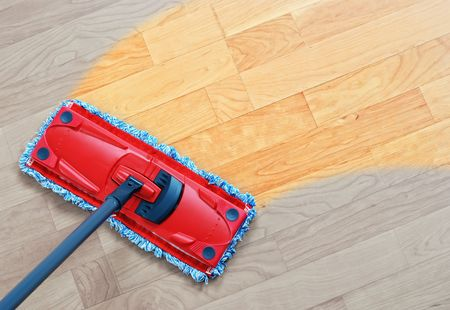 Housework - sweeper wet mop on laminate floors.