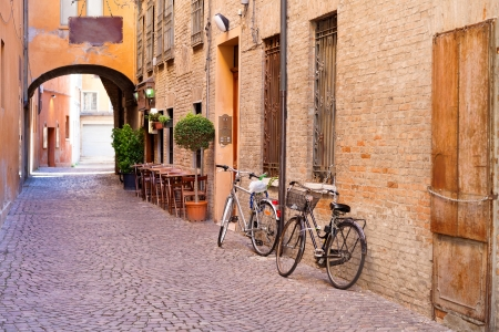 Photo pour old small stone medieval street in historical center of Ferrara, Italy - image libre de droit