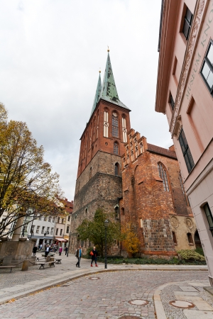 BERLIN, GERMANY - OCTOBER 17: Nikolaikirche in Nicholas Quarter in Berlin on October 17, 2013. District Nikolaiviertel was founded about 1200, now it is the reconstructed historical area inl Berlin