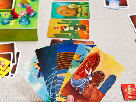 MOSCOW, RUSSIA - FEBRUARY 3, 2014: card pack in Dixit game. The game was created by Jean-Louis Roubira in 2008, and in 2010 the game received prestigious award Spiel des Jahres (Game of the Year)