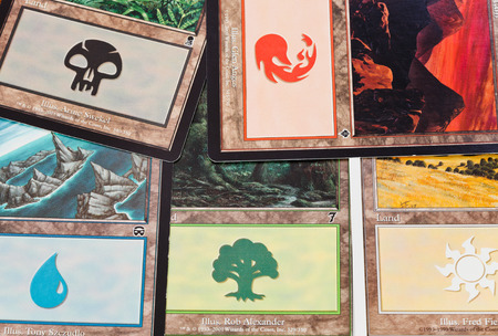 Photo pour MOSCOW, RUSSIA - MARCH 24, 2013: The Land cards of game Magic: The Gathering. The game was created by Richard Garfield and first published in 1993 by Wizards of the Coast. - image libre de droit